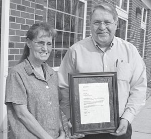 New Buckeye             Lake Postmaster Chris Johnson presents clerk Molly Ewing with an             award recognizing her 25 years of service. She began her career in             1981 at the Newark Post Officeas a city carrier. She transferred to             Buckeye Lake in 2000 to work for former Postmaster Becky Borland.