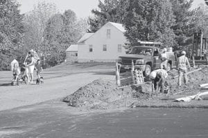 Shelly Company workers prepare forms for a sidewalk along Park Drive in Thornville. Pedestrians have been forced to walk in the roadway. Courtesy photo.