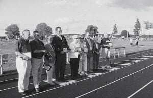 Nine members, two posthumously, were inducted into the first class of the Lakewood Wall of Fame Friday, August 31. The Wall of Fame was created to honor those individuals or groups whose actions or achievements in their chosen fields bring honor and distinction to the heritage of the Lakewood community. From left to right, Dr. Richard Walters; Don Thorp; Donna Braig; Robin Braig; Mrs. Mame Calhoun, representing her late husband, John W. Calhoun; Nancy Schrider Dix; Dave Porter, representing his late teacher, Carrie B. Hutzell; Ila Jean Mason; and Jim Mitchen. Each honoree was nominated for the honor. Lakewood plans to induct additional members each year. Beacon photo by Charles Prince.