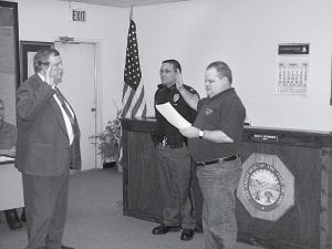 Millersport Mayor Dean Severance, right, gives the oath of officeto Harold Crabtree while interim Police Chief Randy Lewis looks on. Crabtree is the village's first auxiliary police officerand its most experienced. He served 26 years with the City of Columbus Division of Police with most of his service in the Detective Bureau. Crabtree also was patrol commander at Port Columbus for 10 years and was a deputy Ohio Attorney General. Beacon photo by Charles Prince.