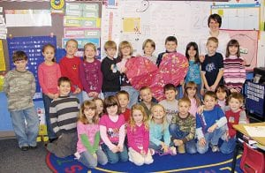 Liberty Union Elementary School teacher Wendy Buskirk's first grade class proudly displays a Valentine's Day card they created for Trey Martens