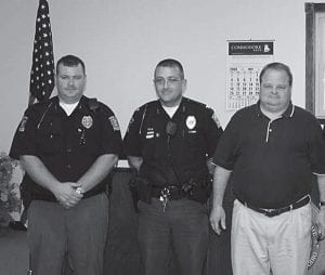 Millersport Mayor Dean Severance, right, gave the oath of officeto Kevin Gentzel, left, during the May 13 village council meeting. Gentzel has a total of seven years experience, serving as a deputy with the Perry County Sheriff's Officeand an auxiliary officerwith the Thornville Police Department. He and former Reserve OfficerJohn Shirk will be paid part-time officers, working about 20 hours a week each. Shirk retired from the Columbus Division of Police. Police Chief Randall Lewis, center, is full-time. Council members also unanimously approved a resolution increasing Lewis' salary to $28,000 a year. He has created a department website at www.millersportohio.com/police. Beacon photo by Charles Prince.
