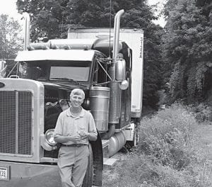 Above, South Fork Road resident Joe Simon stands beside a truck, which prevents the T.J. Evans Foundation from paving a Licking Township rail bed for use as a bike trail. Property owners, above right, are blocking the former rail bed to prevent The Shelly Company from extending pavement south into Licking Township. Beacon photos by Scott Rawdon