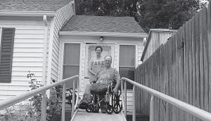 Hebron residents Jack and Jan Yocum stand atop a wheelchair ramp donated Aug. 17 to Jack, a member of the Men's Auxiliary VFW Post 1388, by his fellow members. Yocum has been in and out of the hospital the past several months.