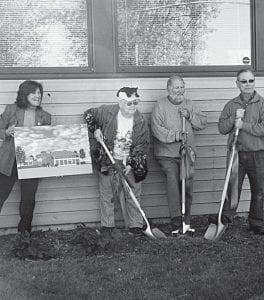 The Greater Buckeye Lake Historical Society broke ground on its Phase III expansion on Sunday, Oct. 19. From left to right are Buckeye Lake Museum Director J-me Braig holding an architect's rendering of the expansion, Norma Dixon of Fairfield Beach, museum board President Fred Bair and museum board member John Hoermle. Dixon's bequest of her entire estate to the society is funding the expansion which includes adding a glass atrium on the front of the museum along Ohio 79 and a two-story display area to the rear of the existing building. The restored rocket ship from the Buckeye Lake Amusement Park will be displayed in the atrium. Dixon also donated her large collection of bears, dolls, and Native American artifacts to the museum. The new addition will be named the Bard & Dixon Family Building in her honor. Beacon photo by Charles Prince.