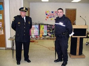 Baltimore Police Chief Michael Tussey (left) and officer Jason Hargett help to introduce Fairfield County's new S.C.A.L.E. program