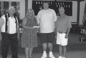 Buckeye Lake Eagles Aerie 2801 recently donated $2,500 in critically needed funds to help the Buckeye Lake Library stay open. From left to right, Trustees Jim Gaffey, Roger Dupler and Dwight Caudell present the donation to Pam Reed, president of the Friends of the Buckeye Lake Library, Inc. The Friends are responsible for paying utilities, insurance and building maintenance. Beacon photo by Charles Prince.