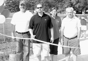The ribbon is cut to the new Glenford Walking Trail in the Glenford Lions Club Park. From left to right are Jim Cade, Eric Correll, Theresa Hasten, and Frank Correll. Courtesy photo.