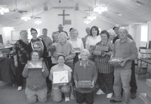 First Community Church Coordinator Kellie Vaughn and the Joy Bible Class assembled 100 Christmas gift boxes for the Samaritan's Purse Operation Christmas Child program. Beacon photo by Scott Rawdon