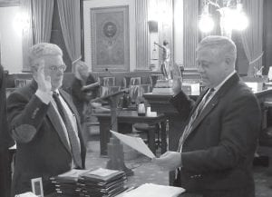 Licking County Court of Common Pleas Judge Thomas Marcelain, right, administers the oath of office to new Conservancy Director David A. Lipstreu of Granville. Lipstreu will complete the remaining two years on John Weaver's term. He has spent most of his career as a land planner, serving most recently as the Director of Planning and Zoning for the City of Aurora, Oho. Weaver recently retired after 41 years service as a volunteer director. Beacon photo by Charles Prince.