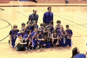 Lakewood Middle School's 7th Grade boys basketball team won the Mid-State League Championship last Friday. FFrom left to right front row are Devin Carr, Andrew Embry, Jordan Dutiel, Chance Rose, Erik Thomson, Cody Nauer, Christopher Briggs and C.J. Dutiel. In the back row are Nick Phillips, Reese Dupler, Kory Thomson, Jarrod Chorpening, Zack Holbrook, Major Henry and Daylin Loomis. Standing are CoachesRodger Dupler and Jarred Mayberry. Courtesy photo.