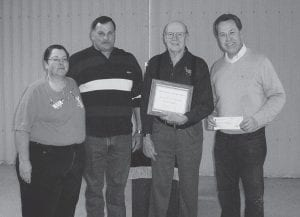 Buckeye Lake Fraternal Order of Eagles 2801 recently donated $8,000 to the Village of Buckeye Lake toward the purchase of a used police cruiser. From left to right are Ladies Auxiliary President Maryanne Hagan, Police Chief Ron Small, Eagles President Roland West and Mayor Rick Baker. Courtesy photo.