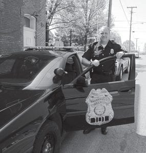 New Thornville Police Chief Darrell Ball takes a break from street patrol. Beacon photo by Scott Rawdon.