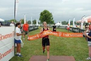 Julie Rechel of Westerville crosses the finish line, winning the Columbus Trek Women Triathlon Series event at Buckeye Lake Sunday. Courtesy photo.