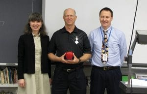 Licking County Foundation Director Connie Hawk (left) and Lakewood Middle School Principal Jim Riley (right) present Lakewood Middle School math teacher Criss Nadolson (center) with the Leaders for Learning Award. Beacon photo by Scott Rawdon.