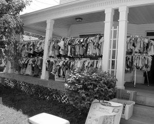 Pam Stratford had her porch well stocked with clothing Wednesday afternoon. Beacon photo by Scott Rawdon.