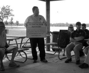ODNR's 'Algae King' Scott Fletcher explains the advisory signs Wednesday morning at the North Shore Boat Ramp. Beacon photo by Scott Rawdon.