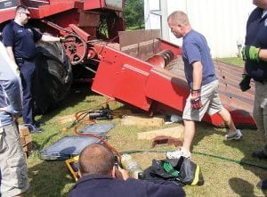 Firefighters practice removing a person trapped under a combine. Courtesy photos.