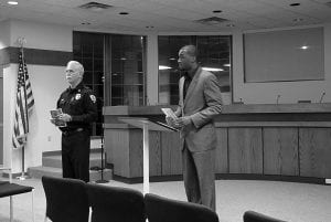 Hebron Police Chief James Dean and Cornelis McGrady of the Ohio Attorney General's Office answer questions about elder fraud. Beacon photo by Charles Prince.