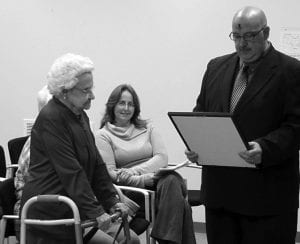 """Hebron Mayor Clifford L. Mason reads a proclamation honoring Hebron resident Dorothy """"Dotie"""" Wells on her 100th birthday. Mason said Wells, """"Touched the lives of thousands of Ohio residents through her 40 years of serving countless meals in numerous restaurants…and has the very special ability to make every person who knows her, proud to share their friendship."""" Beacon photo by Charles Prince."""
