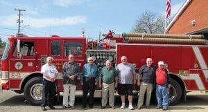 Hebron officials broke ground on April 20 for their fire station renovation/ addition project. All living Hebron Fire Chiefs were present. Above, from left to right, are Fire Chief Randy Weekly; former Fire Chiefs Bill Ours, Jim Sheets, Denny Davis, Rich Moore and Donard Myers; and Honorary Chief Mike Price. At right, from left to right, Hebron Mayor Clifford Mason, Weekly, Andy Shelton of 2K General Contractors and Architect Greg Cotterman of JBA Architects took the first shovelfuls of soil. Construction started Monday and is expected to be complete by mid-December. Beacon photo by Charles Prince.