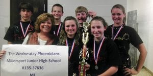 """After winning honors for creativity and problem solving in local, state and regional tournaments, an 8th grade team from Millersport Jr. High is heading to Destination Imagination's Global Finals -- the largest creative thinking and problem solving competition in the world -- May 23-26 in Knoxville, TN. They will compete in Project Outreach, one of seven difficult, open-ended challenges that require youth to apply science, technology, engineering and math (STEM), in addition to improvisation, theater arts, writing, project management, communication, innovation, teamwork and community service challenges. """"We are extremely grateful to Angie Ulrich, who got us involved in Destination Imagination in the first place and to our school district and community for all their support,"""" said Team Manager Lori Dupler. Pictured above, left to right, are Nick Fry, Team Manager Lori Dupler, Paul Sherrer, Morgan Murphy, Ammon Keller, Olivia Osborn, and Genna Heileman. Courtesy photo."""