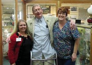 Cedar Hill Care Center resident Howard Van Wert tours the Buckeye Lake Museum with Activity Director Karen Solt (left) and Head Nurse Coordinator Francis Roberts.