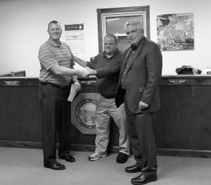 Fairfield County Commissioner-elect Dave Levacy, right, and Mayor Dean Severance, center, congratulate Dustin Bidwell on his selection to fill out the rest of Levacy's term on village council. Beacon photo by Charles Prince.