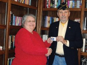 Thornville American Legion Post 342 recently gave $300 for the benefit of residents at Autumn at the Lake. The gift is not restricted to veterans. Doug Lynn, Post Chaplain, presented the check to Dawn Groghen, Activities Director at Autumn at the Lake. Courtesy photo.