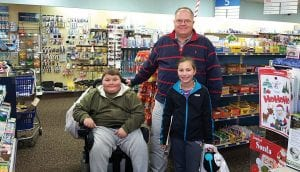 Millersport Elementary School teacher Tracey Tisdale recently designed a writing project for fifth and sixth graders focusing on the benefits of shopping local. Small groups of students visited local businesses asking owners/managers questions about their businesses and how they operate in Millersport. Above, students Roy Maynard and Jasmine Jordon met with Pharmacist Gary Haga at the Millersport Pharmacy. Courtesy photo.