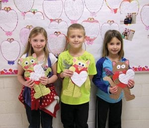 Millersport first graders Kaylee Wallen, Zack Montgomery, and Emily Blevins are happy Valentines!