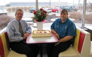 """Hebron McDonald's owner Don Kissack presents a cake and flowers to his General Manager Sandy Shaw, who was recognized as an """"outstanding"""" restaurant manager Feb. 13."""