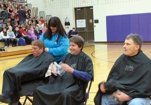 Above from left to right, Walnut Township Schools district treasurer and Millersport head basketball coach Kirk Grandy, biology teacher Steve Harris, and maintenance/ transportation supervisor Mike Washburn anxiously wait to learn who will 'win' a very close haircut. Right, Harris' new look and duct tape can't hold everything. Beacon photos.