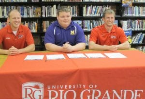 University of Rio Grande director of track & field/cross country Steve Gruenberg has announced the signing of Millersport High School's Sammy Little for the 2014-15 school year. Little, a 6-foot-2, 345-pound thrower, was a first team All-Central District and a second team All-Mid-State League performer for head coach Steve Pierce's Lakers as a junior. Little, who was also named his team's Most Valuable Thrower and Most Valuable Field Event Athlete, competes in the discus, shot put and weight throw. His personal-best marks include 120-5 in the discus, 46-3 in the shot put and 31-7.75 in the weight throw. Little is the son of Joe and Stephanie Little of Millersport. He is joined by coaches Nick Wilson, left, and Steve Gruenberg. Photo courtesy University of Rio Grande.