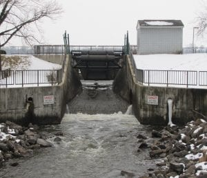 What's wrong with this photo? It's March 4 and the gate on the regulatory spillway in Buckeye Lake Village is still open. Tuesday's heavy rain is rushing away, leaving the lake three-feet below full pool. Beacon photo by Charles Prince.