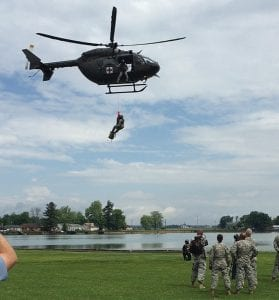 National Guard members, ODNR officers and staff members and Emergency Management Agency officials appeared to outnumber spectators at last Saturday's Buckeye Lake Safety Day at Buckeye Lake State Park on Liebs Island. At left, an Ohio National Guard helicopter demonstrates a land rescue using its hoist. A larger Guard helicopter demonstrated a water rescue again using a hoist. The small turnout wasn't surprising since the event wasn't publicly announced until last Wednesday. Photo by Abbi Snyder.