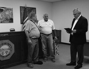 Millersport Mayor Dean Severance, left, is thanked by Mayor's Assistant Vince Popo, center, and Fairfield County Commissioner and former Millersport Council President Dave Levacy Tuesday night. Beacon photo by Peggy Wells.