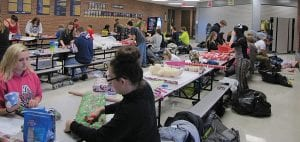 Millersport High School and MIddle School students and other volunteers wrapped stacks of presents for the White Christmas program at Millersport High School Tuesday afternoon. The gifts will be distributed throughout the Millersport community Dec. 17 along with gift fruit baskets to thank area senior citizens by Millersport Lions Club members and high school seniors. Millersport teachers Lori Dupler, Morgan Singer, Stevi Workman, and Megan Terry worked together to organize the project this year. This year, the Millersport Volunteer Firefighters Association formally aligned its annual Toy Drive, now in its 14th year, with White Christmas. Beacon photo by Scott Rawdon.