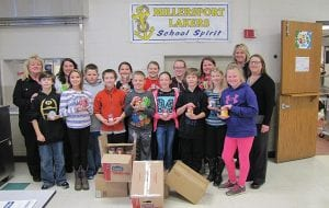 """The Millersport Elementary School Student Council didn't forget the community's four-legged family members this year when they decided to help sponsor a pet food drive through Meals on Wheels to collect canned dog and cat food for local families in need. In all, they collected about 340 cans of pet food to be distributed throughout the community. """"We started this about six years ago when we saw the need,"""" said Fairfield County Meals on Wheels Director of Operations Cindy Wells. She said it became apparent some Meals on Wheels recipients were offering significant portions of their meals to their pets, so they began asking schools to collect pet food donations. Fairfield County Meals on Wheels Executive Director Anna Tobin said only four schools, including Millersport Elementary, responded. She thanked student council members and their advisor, Millersport teacher Katie Galbreath, for accepting the challenge and and conducting a successful drive. Beacon photo by Scott Rawdon."""