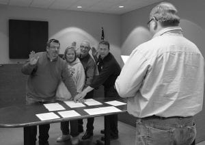 Buckeye Lake Mayor Clay Carroll administers the oath of office to council members, from left to right, Tom Wolfe, Arletta Ruton, Robert Masone M.D. and Doug Poorman D.V.M. Monday night. Beacon photo by Scott Rawdon.