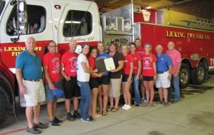 """The Division II State Champions Lakewood Lady Lancers and their coaches felt right at home Monday night at the Licking Township Fire Company. Players and coaches get the """"greatest ride on Earth"""" on top of the fire company's equipment after each district, regional and state tournament championship. Beacon photo by Scott Rawdon."""