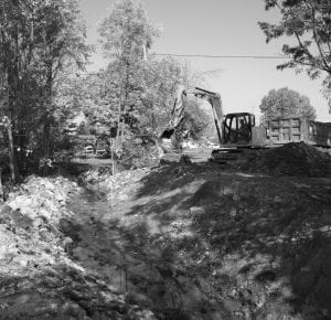 Looking toward North Street, the old railroad culvert that restricted water flow is now gone. Concrete slabs from an old bridge have been repurposed as rip rap to provide the bank from erosion. Beacon photo by Charles Prince.