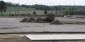 A bulldozer spreads fine aggregate over the coarse aggregate drainage layer for Lakewood's synthetic turf football stadium. The nearly $3.3 million project ($2.8 million funded by the district) is on schedule. The dedication is set from 6 p.m. on Thursday, August 17, with a Meet the Team event. Beacon photo by Charles Prince.