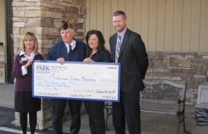 """Jerry Price, second from left in both photos, was named Park National Bank's fifth Hebron area Difference Maker at the bank's annual Hebron community breakfast last week. Price was called a """"quiet difference maker"""" who works tirelessly for the Hebron American Legion, Veterans' widows and basically anyone who needs help. The award includes a $500 donation from the bank to a non-profit selected by the award winner. Price selected the Lakewood Drama Boosters. He quipped, """"Maybe I will have to work a bit harder for you guys (his American Legion friends)."""" """"We've got difference makers everywhere,"""" he told Hebron community leaders. He lost his father early in his life and learned the value of hard work from his grandfather. His grandfather also taught him that """"every man was the same."""" Top photo, from left to right, Hebron branch assistant manager Janet Springer; Jerry Price; his daughter, Mindy Kester; and Hebron branch manager Cody Smailes. Bottom photo, from left to right, Mike Price; Jerry Price; his wife, Annette; his daughter, Mindy Kester; and his son-in-law, Kevin Kester. Hebron Mayor Mike McFarland presented an Award of Excellence to Park National Vice President Karen Rice for 65 years of exceptional service to the Hebron Community. McFarland and Lakewood Superintendent Mary Kay Andrews highlighted the past year for the village and school district. Beacon photos by Charles Prince."""