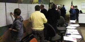 Millersport residents use color dots to prioritize their project choices Tuesday night. Beacon