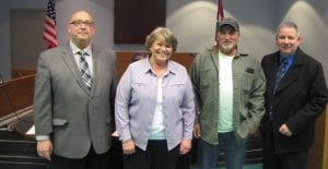 Buckeye Lake Village Mayor Peggy A. Wells administered the oath of office Monday night to three new village officials. From left to right, Interim Fire Chief Clifford L. Mason, Wells, Zoning Officer Doug Steward and Code Enforcement Officer Rex Adkins. Beacon photo by Charles Prince.